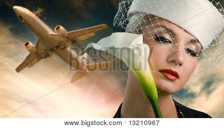 Sexy stewardess and flying plane