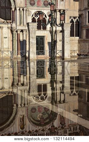 Saint Mark Basilica southern facade reflection during Venice Acqua Alta (high tide)