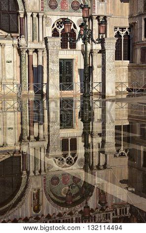 Saint Mark Basilica southern facade reflection during Venice Acqua Alta (high tide)