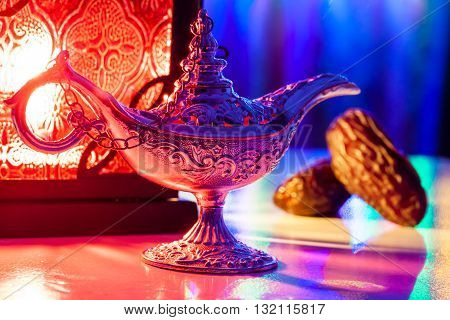 Date fruits, Aladdin's lamp and arabic lantern. Ramadan Eid background concept