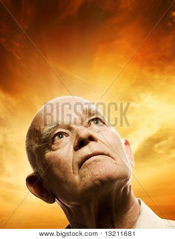 Portrait of an elderly man looking up