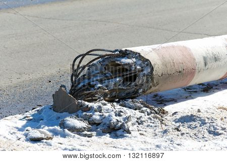 Concrete electric pole fell next to the road (emergency power supply)
