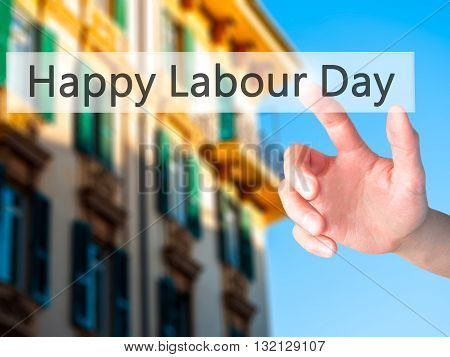 Happy Labour Day - Hand Pressing A Button On Blurred Background Concept On Visual Screen.