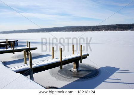 Piers on frozen snow-covered lake