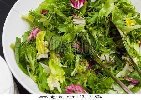 Healthy Raw Green Vegetables In White Bowl For Salad.