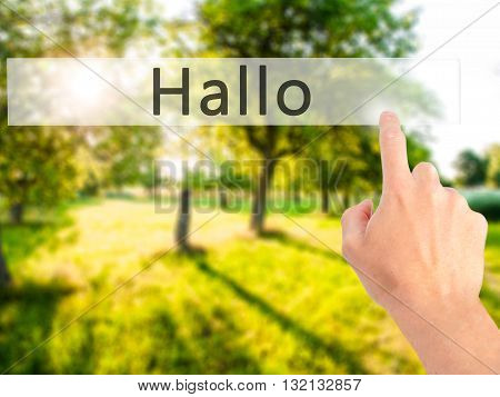 Hallo (hello In German) - Hand Pressing A Button On Blurred Background Concept On Visual Screen.