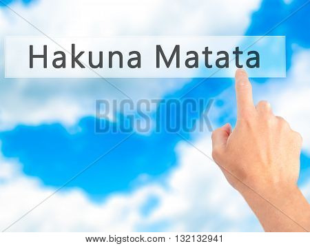 Hakuna Matata (swahili Phrase It Means No Worries)  - Hand Pressing A Button On Blurred Background C