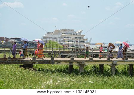 Yangon Myanmar - April 25 2016 : People walking on bridge at Botahtaung Jetty port