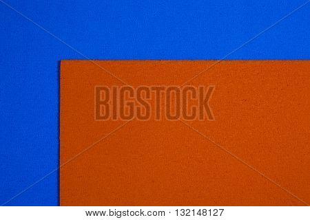 Eva foam ethylene vinyl acetate orange surface on blue sponge plush background