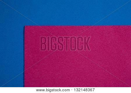 Eva foam ethylene vinyl acetate pink surface on blue sponge plush background