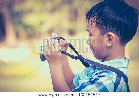 Boy Taking Photo By Camera, On Blurred Nature Background. Active Lifestyle, Curiosity, Pursuing A Ho