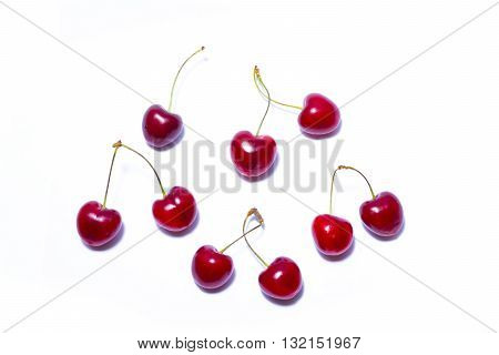 Cherry on a white background with clipping path. Ripe cherry isolated. Sherry berry fruit isolated on white background. Sweet cherry. Red cherry. Cherry on white. Cherry isolated.