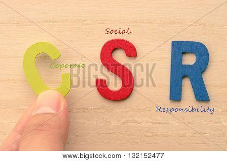 Hand arrange letters as CSR (Coporate Social Responsibility)