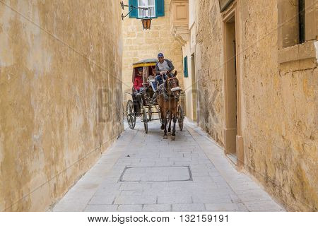 Mdina Malta - May 04 2016: City tour in a stylish carriage - Mdina Malta - Old Capital and the Silent City of Malta - Medieval Town