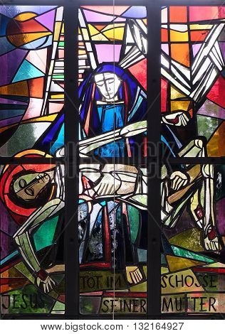 KLEINOSTHEIM, GERMANY - JUNE 08: 13th Stations of the Cross, Jesus' body is removed from the cross, stained glass window in Saint Lawrence church in Kleinostheim, Germany on June 08, 2015.