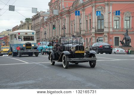 SAINT-PETERSBURG, RUSSIA - MAY 24, 2015: Participants of the parade of retro vehicle moving along Nevsky Prospekt