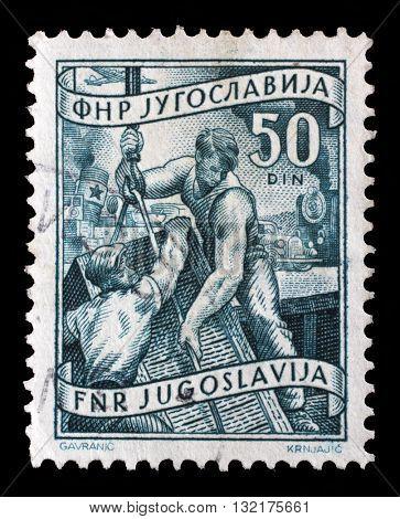 ZAGREB, CROATIA - SEPTEMBER 13: A stamp printed in Yugoslavia shows stevedores, domestic economy Series, circa 1952, on September 13, 2014, Zagreb, Croatia