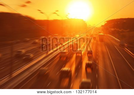 Motion blurred image of city traffic during sunset.