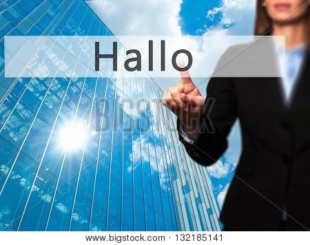 Hallo (hello In German) - Businesswoman Hand Pressing Button On Touch Screen Interface.