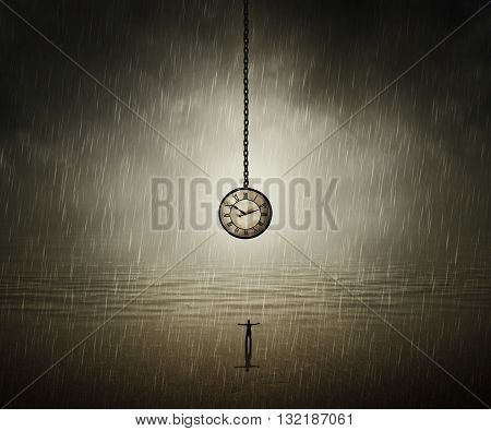 Surreal backround of a man standing with wide opened hands in front of a huge clock near the ocean in a rainy day. End of time. Time travel concept