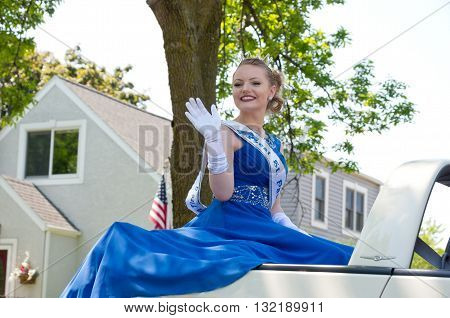 West St. Paul, Minnesota, USA - May 21, 2016: West St. Paul Princess Samantha Thell waves to crowd during West St. Paul Days Grande Parade on May 21, 2016.