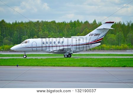 SAINT PETERSBURG, RUSSIA -MAY 23,2015. CS-DRY NetJets Europe Airlines Hawker Beechcraft Hawker 800XP business jet rides on the runway after arrival at Pulkovo Airport