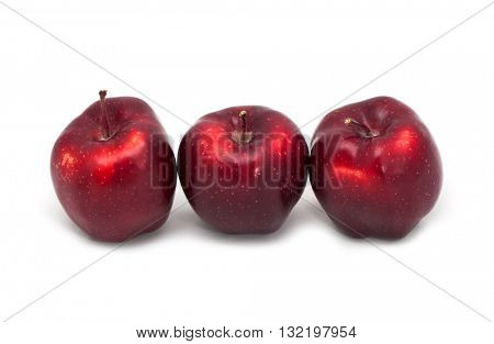 Dark red apples on a white background