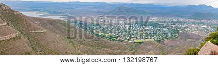 A panoramic view of Graaff Reinet as seen from the road to the Valley of Desolation viewpoint. The town lies in a horseshoe bend of the Sundays River