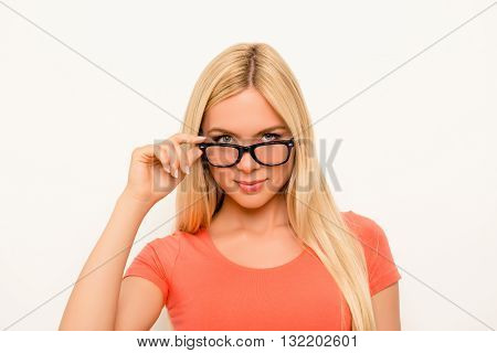Attractive Brainy Young Woman Touching Her Eyewear