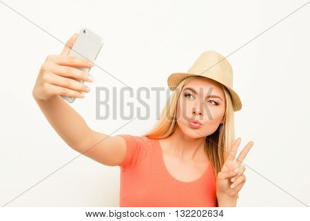Woman In Hat Making Selfie, Pouting  And Showing Two Fingers