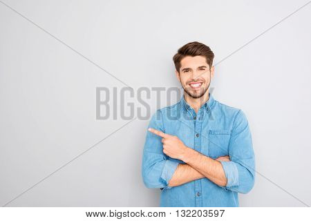 Happy Handsome Guy Showing Way And Pointing With Finger