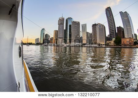 BRISBANE, AUSTRALIA - MAY 25 2016: Cruising the Brisbane river on the free ferry as the sunsets on Brisbane City.