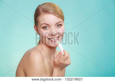Woman Applying Balsam For Lips