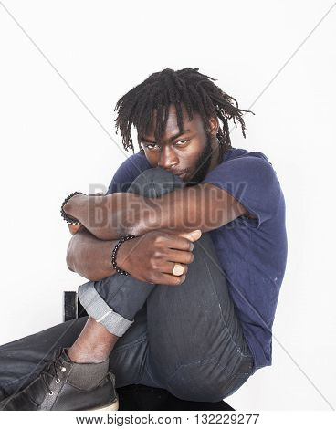 young handsome afro american man, angry look, weed junky isolated on white, problem teenage, depression greef, sad guy
