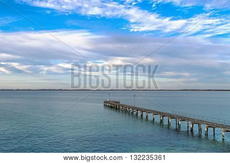 Evening view of Robe Jetty with blue sky and clouds in Robe, South Australia