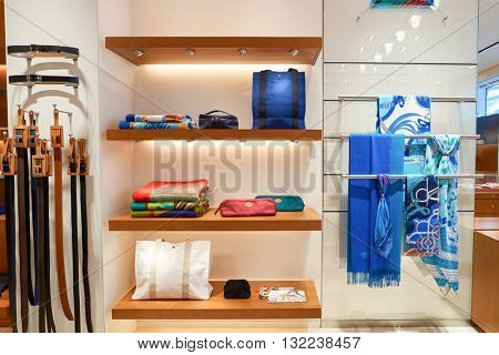 DUBAI, UAE - APRIL 08, 2016: inside of Hermes store at Dubai International Airport. Dubai International Airport is the primary airport serving Dubai, United Arab Emirates