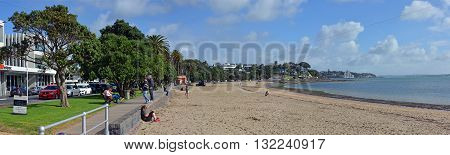Auckland New Zealand - May 22 2016: Panoramic view of St Helliers Beach and people. Auckland New Zealand