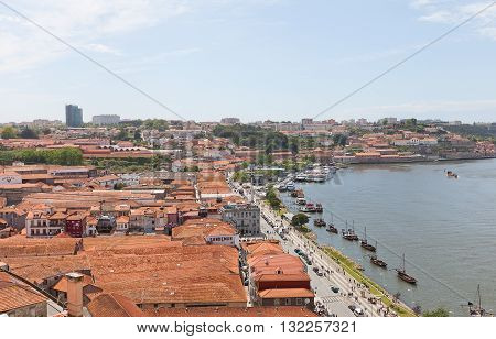 GAIA PORTUGAL - MAY 25 2016: View of Vila Nova de Gaia (UNESCO site). Located on the opposite bank of Douro River from Porto city. Known for cellars where world famous Port wine is stored and aged