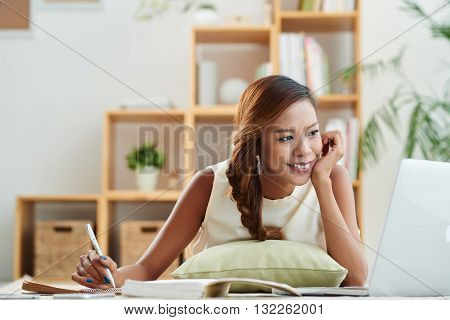Filipino female student doing homework at home