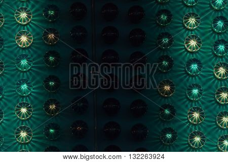 Amusement park background detail with green and yellow lights.