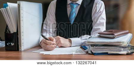 Lawyer pr consultant is analysing contract in office.