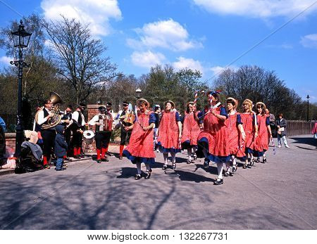TELFORD, UK - APRIL 28, 1991 - Morris dancers with with batons and a brass band at the Blists Hill Victorian Town Madeley Telford Shropshire England UK Western Europe, April 28, 1991.