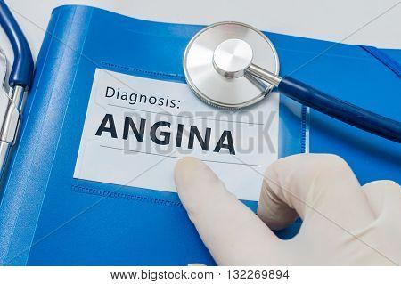 Angina Pectoris Diagnosis On Blue Folder With Stethoscope.