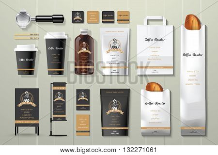 Coffee roaster black and gold corporate identity template design set on wood background