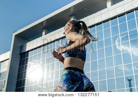 Chelyabinsk Russia - May 24 2016: girl runner participant of race stayers distance of 1500 meters during UrFO Championship in athletics