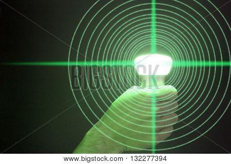 Hand holds a glowing green bulb emitting circular data Lifi concept