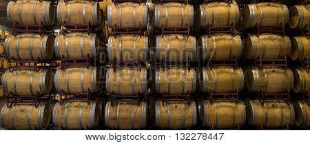 Wine Barrels Stacked In Cellar, Bordeaux Vineyard