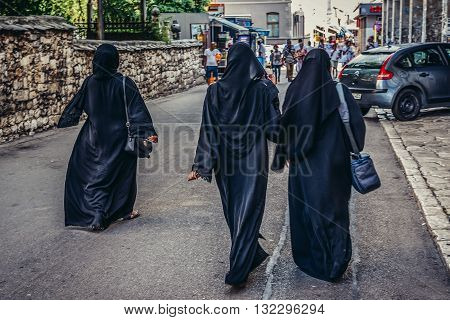 Mostar Bosnia and Herzegovina - August 25 2015. Three Muslim women walks on street in Mostar