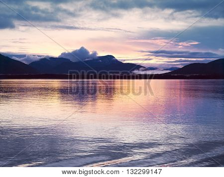 Sunset at Glacier Bay, Alaska. Sunset reflection in the calm waters of Glacier Bay.