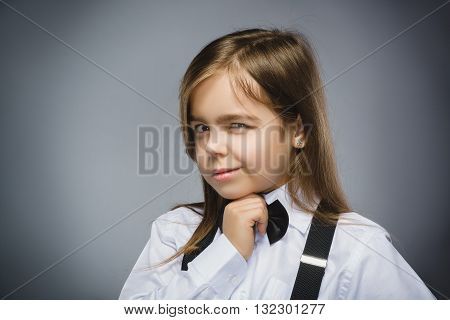 Closeup Portrait of mistrust girl isolated on gray background.